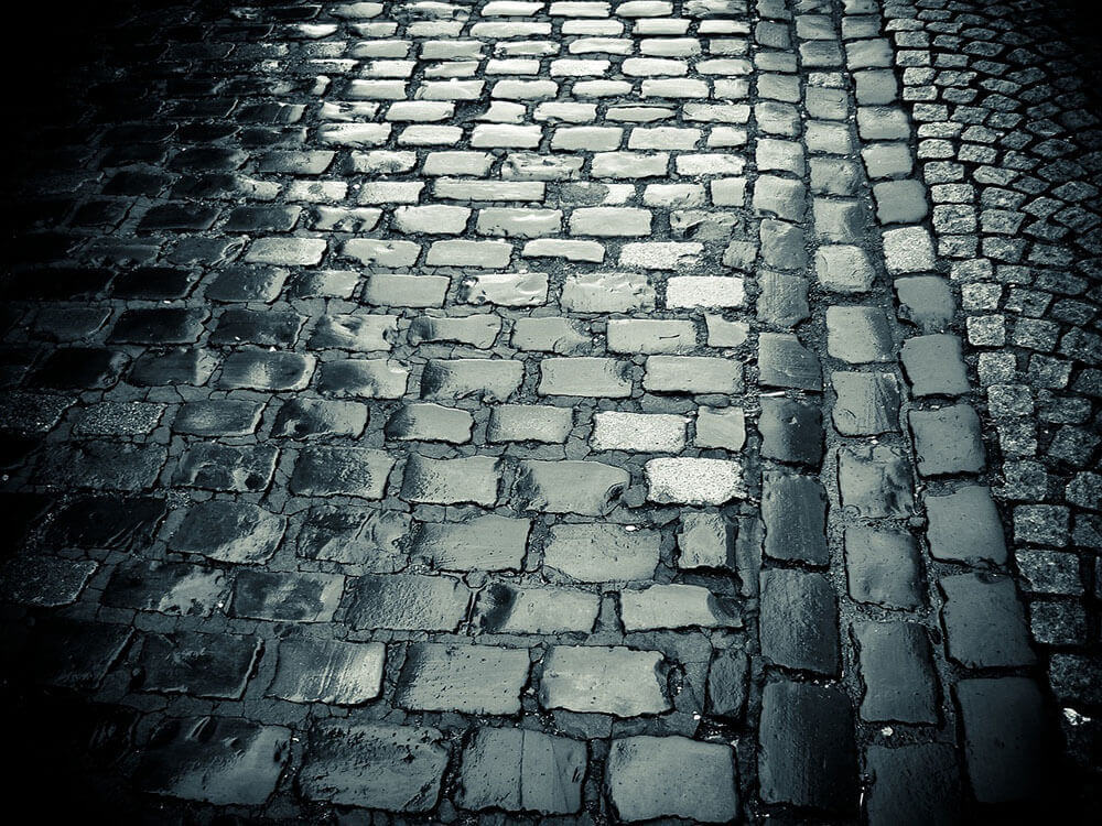 Wet cobblestone road in black and white style