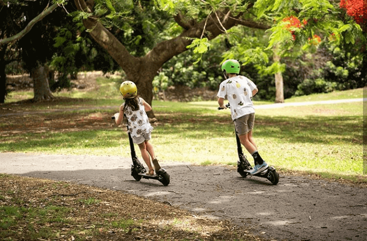Children ride electric scooters in the park. Instagram: Scooter Hut photo credit