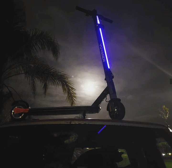 Voyager Ion electric scooter showing its lights in darkness