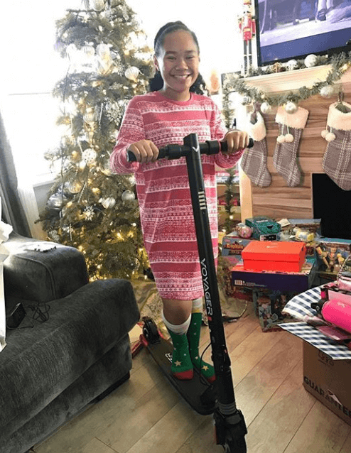 A girl is satisfied with her present - voyager electric scooter