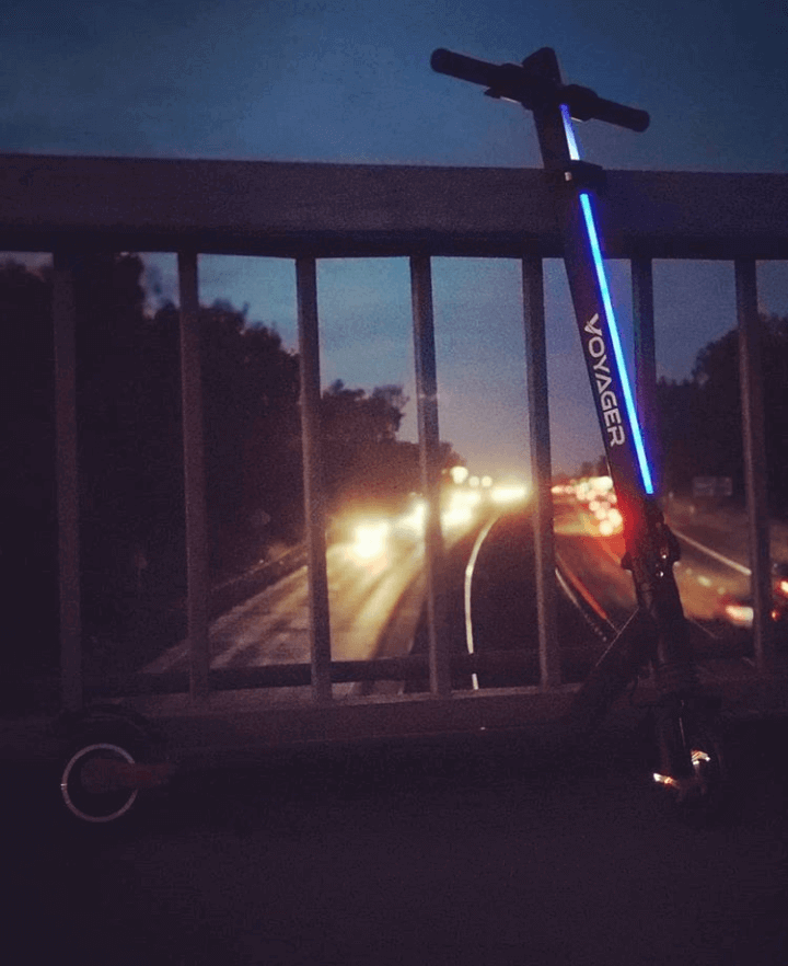 Voyager electric scooter on the bridge over the traffic