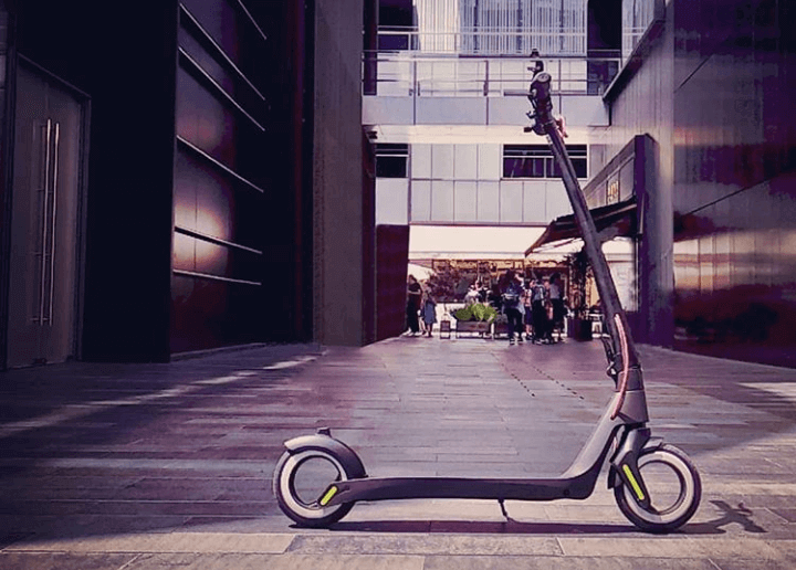 Aktivo electric scooter is parket in the pedestrian zone.