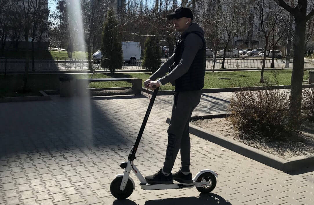 Riding electric scooter for commuting around city