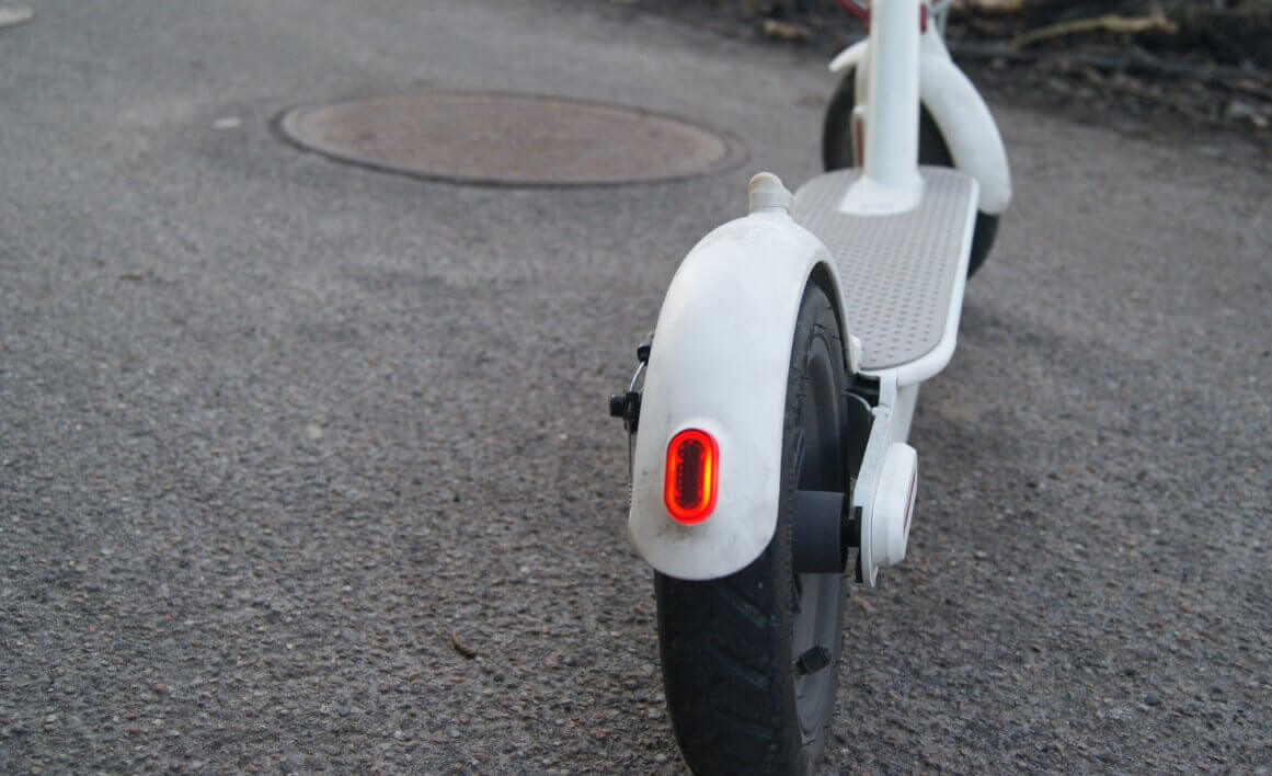 White lectric scooter parked on the road