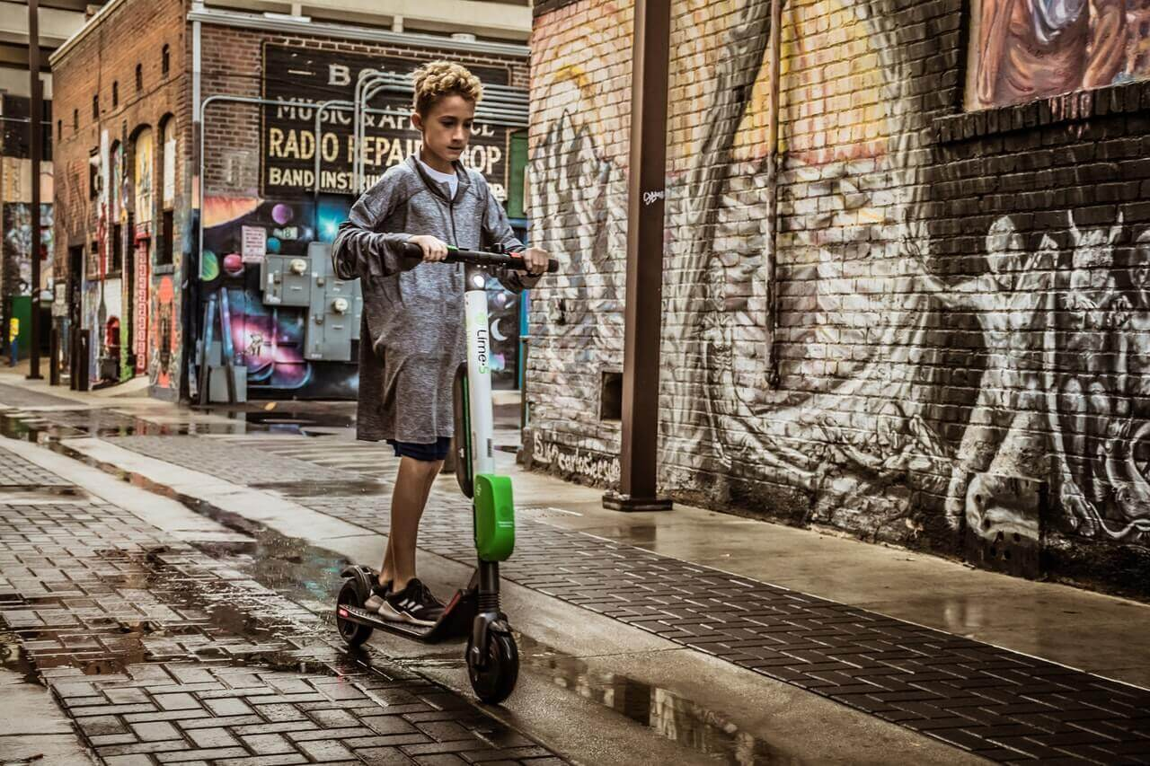 Boy on electric scooter