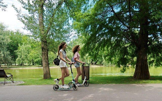 Girls riding escooter