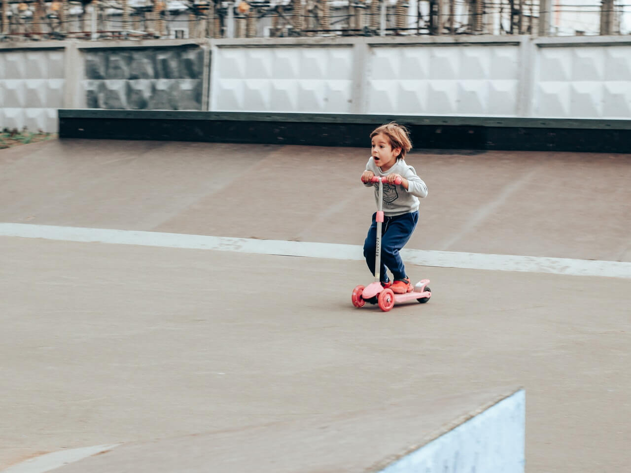 Kid on 3 wheel electric scooter